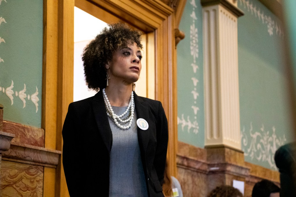 Elisabeth Epps watches as Rep. Leslie Herod makes the case for HB-1226 on the state House floor, April 19, 2019. (Kevin J. Beaty/Denverite)