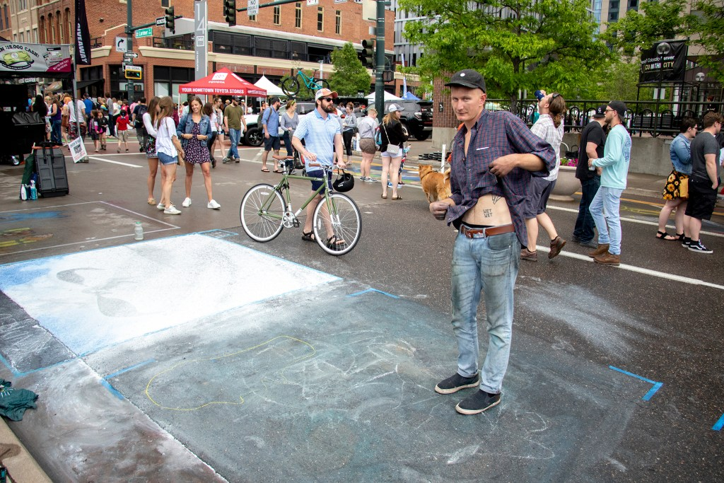 Justin Decou poses for a portrait after it rained over the Denver Chalk Art Festival at Larimer Square, June 1, 2019. (Kevin J. Beaty/Denverite)