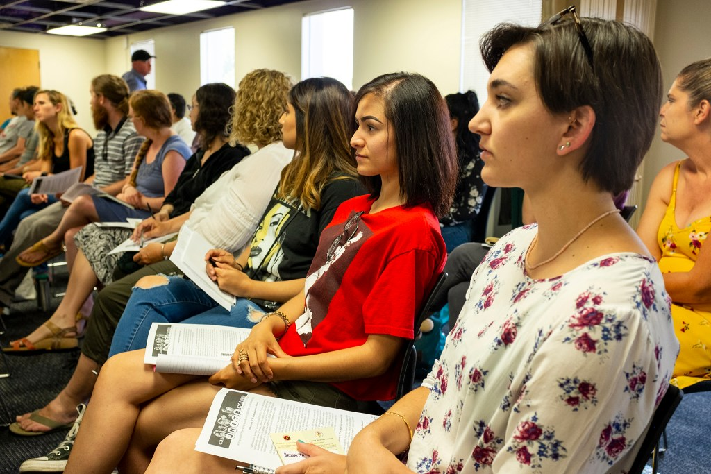Blaise DeFranco (from right) and Karina Lozano attend a volunteer training  for the Colorado Rapid Response Network, June 29, 2019. (Kevin J. Beaty/Denverite)