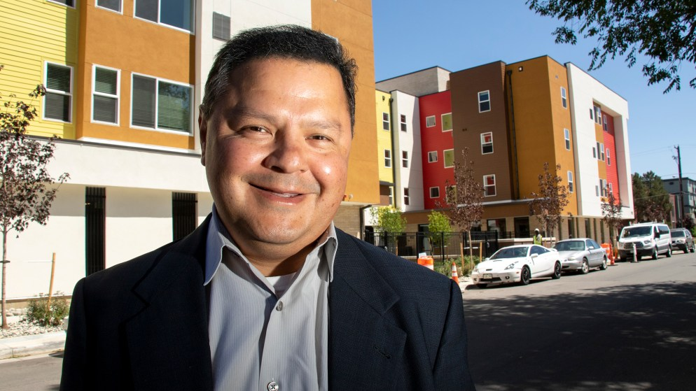 Jeff Martinez, president of Brothers Redevelopment Inc.,  poses for a portrait outside of his housing project in Aurora, July 10, 2019. (Kevin J. Beaty/Denverite)