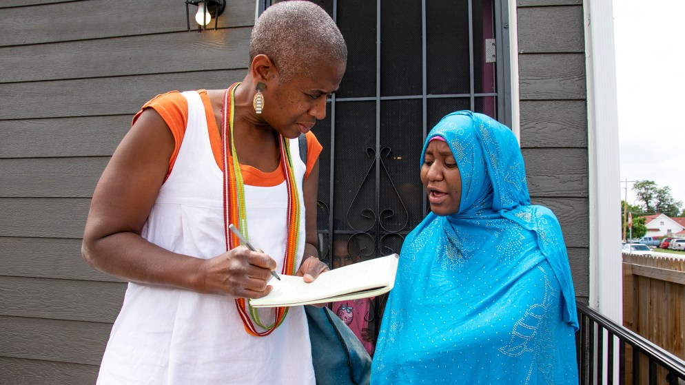 Hawa Haji speaks to a reporter outside her home in Habitat for Humanity's Sheridan Square neighborhood, June 26, 2019. (Kevin J. Beaty/Denverite)