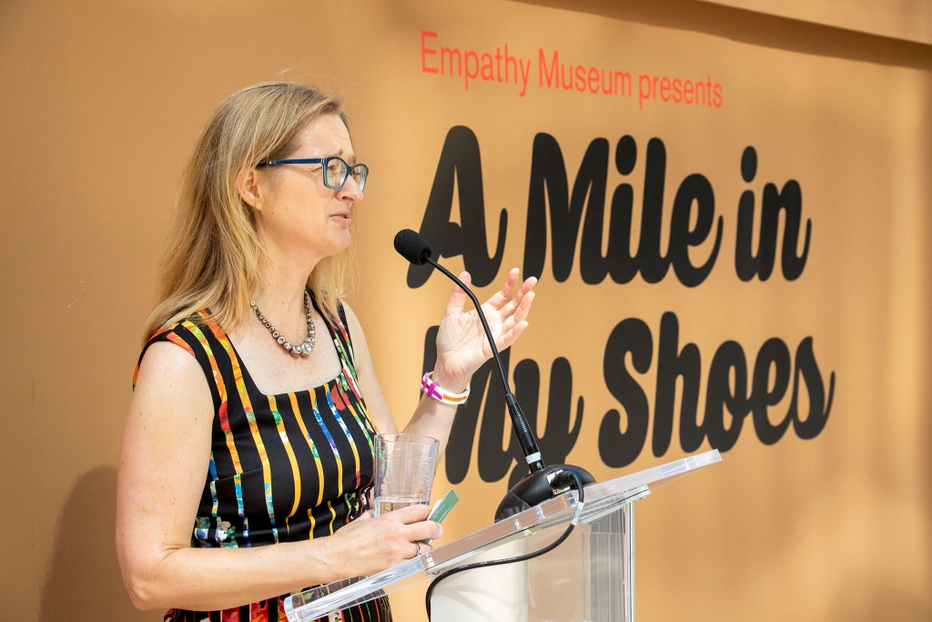 "Erin Trapp, executive director of the Biennial of the Americas, introduces the Empathy Museum's traveling ""A Mile in My Shoes"" exhibit downtown. Aug. 8, 2019. (Kevin J. Beaty/Denverite)"