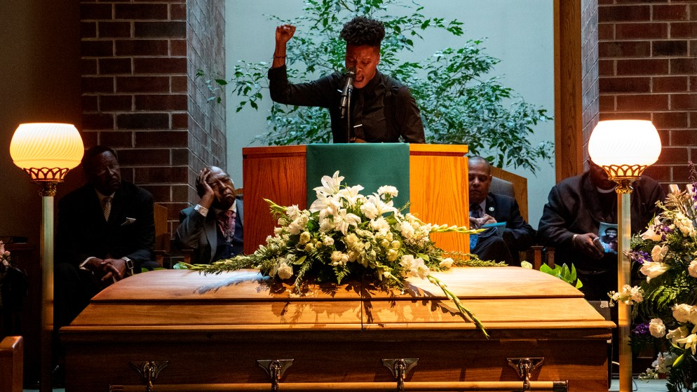 Kerrie Joy reads a poem to open a funeral for Lauren Watson, founder of Colorado's Black Panther Party, Aug. 21, 2019. (Kevin J. Beaty/Denverite)