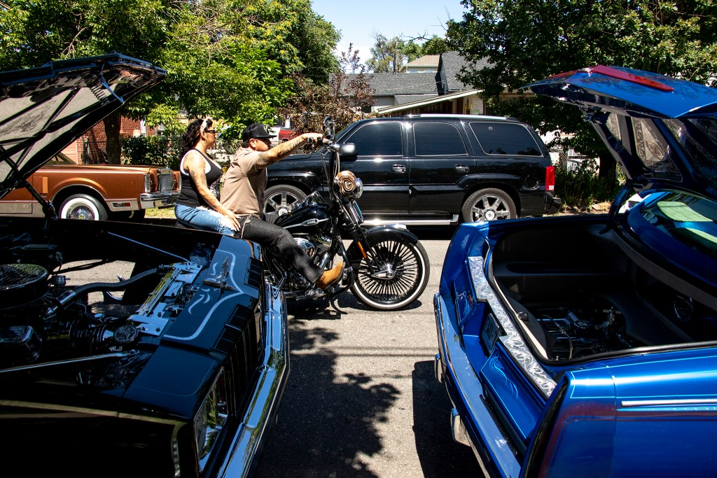 Motorcyclists circle around La Raza (or Columbus) Park before a cruise down Federal Boulevard. Aug. 25, 2019. (Kevin J. Beaty/Denverite)