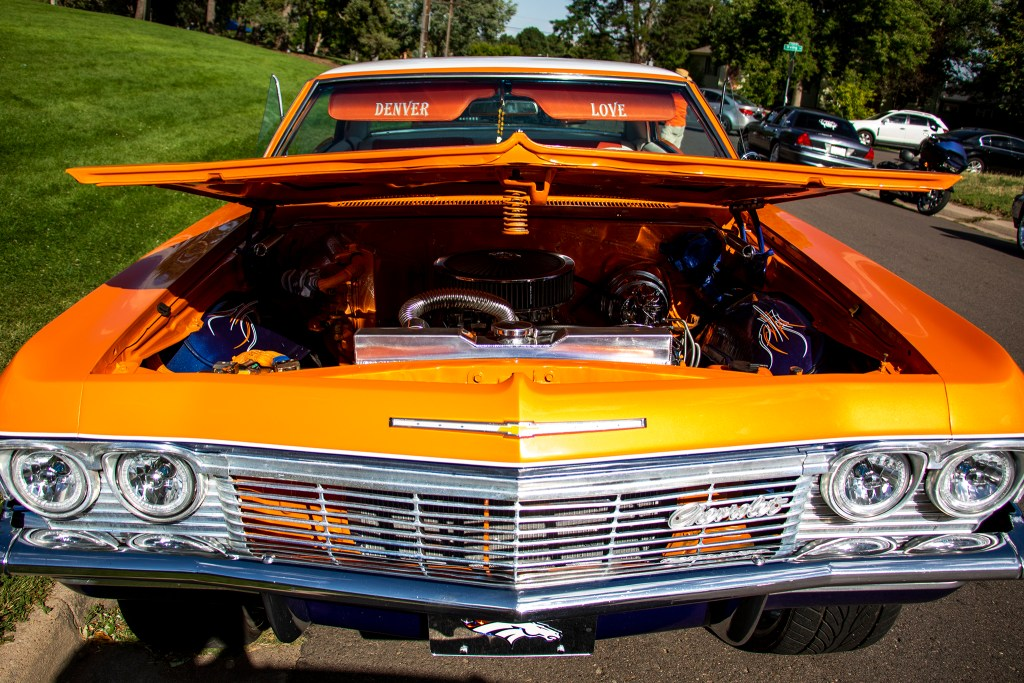Mikey Bartolo's Denver-themed low rider is parked at Barnum Park after a cruise down Federal Boulevard. Aug. 25, 2019. (Kevin J. Beaty/Denverite)