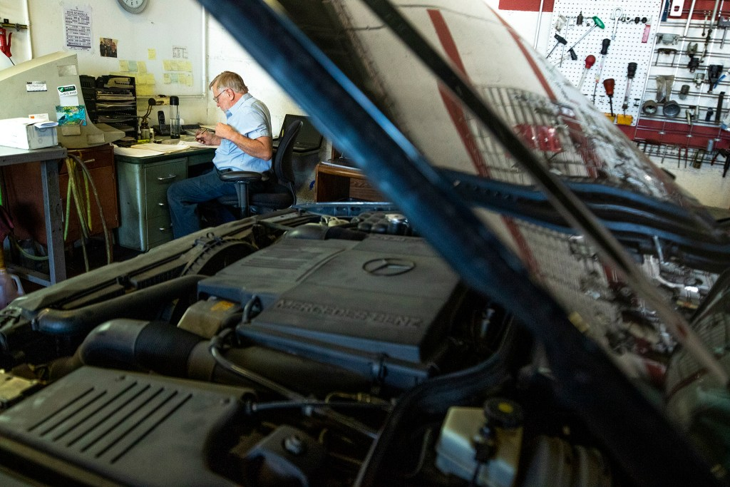 Gary Uhlenbrock, co-owner of Perfection Motors, at work in his shop on Brighton Boulevard, Five Points, Sept. 19, 2019. (Kevin J. Beaty/Denverite)