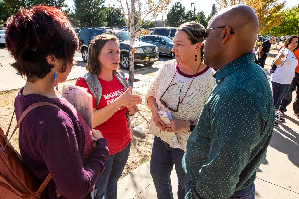 Abbey Winter speaks to Mayor Michael Hancock and City Councilwoman Stacie Gilmore during a gathering to discuss youth gun violence outside of the Green Valley Ranch Recreation Center, Sept. 28, 2019. (Kevin J. Beaty/Denverite)