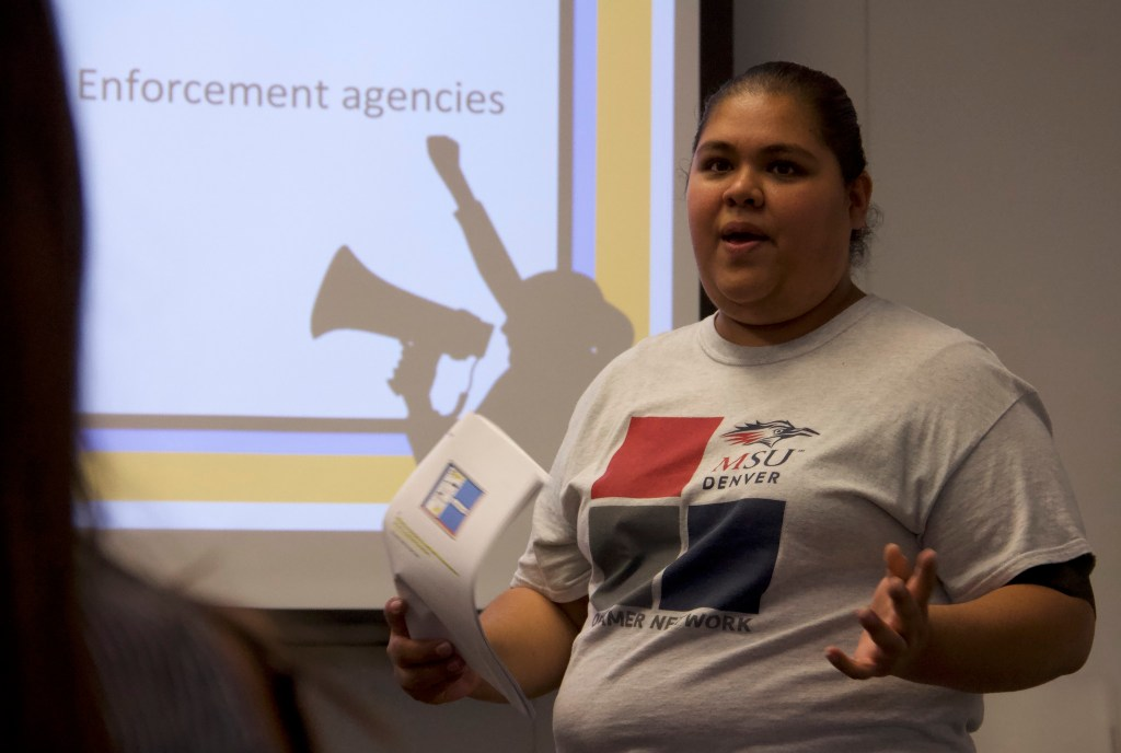 "Ariadna Ochoa Magallanes leads a ""Know Your Rights"" discussion on Thursday, Sept. 26, 2019, at Metro State University in Denver. (Esteban L. Hernandez/Denverite)"