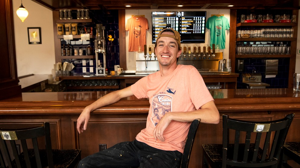 Chris Bell of Call to Arms Brewing Company poses in his bar on Tennyson Street, Oct. 1, 2019. (Kevin J. Beaty/Denverite)
