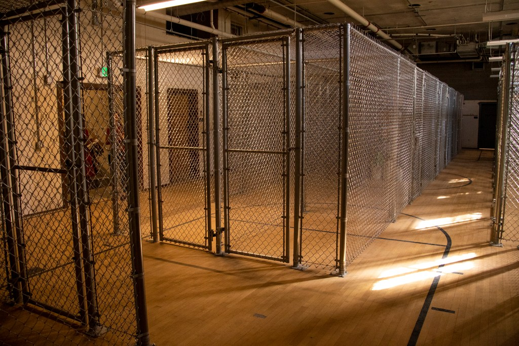 Tammen Hall's old basement basketball court has been turned into resident storage. Oct. 15, 2019. (Kevin J. Beaty/Denverite)