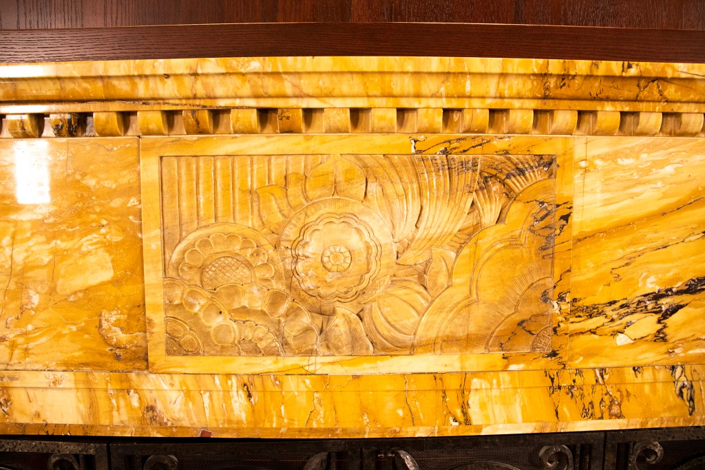 A historic, carved fireplace inside the community room at Tammen Hall. Oct. 15, 2019. (Kevin J. Beaty/Denverite)