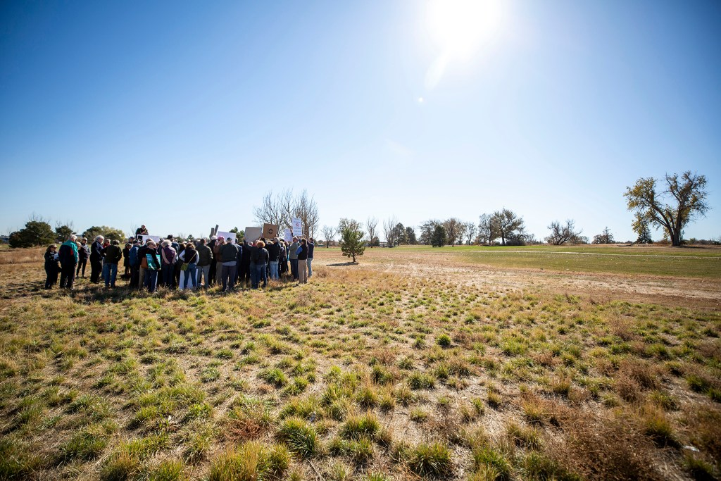 Activists rally on the edge of Park Hill Golf Course demanding the space not be redeveloped. Oct. 22, 2019. (Kevin J. Beaty/Denverite)