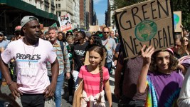Swedish environmental activist Greta Thunberg, center, takes part during the Climate Strike, Friday, Sept. 20, 2019 in New York.  Rallies calling for action on climate change are happening in cities around the world Friday ahead of a summit on the issue.  (AP Photo/Eduardo Munoz Alvarez)