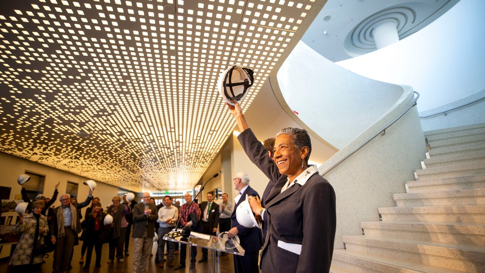 "Denver Deputy Mayor Allegra ""Happy"" Haynes ceremoniously removes her hard hat as Denver Art Museum officials celebrate the end of their new Martin Building's construction phase and the start of their ""museum making"" stage. Nov 13, 2019. (Kevin J. Beaty/Denverite)"