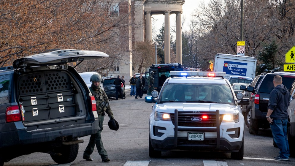 Denver Police pack up after a standoff with a suspect on Humboldt Street near Cole Arts and Sciences Academy. Nov. 22, 2019. (Kevin J. Beaty/Denverite)