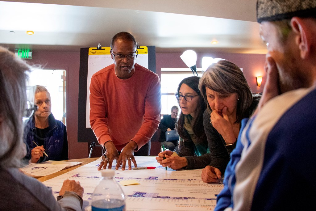 Senior city planner Eugene Howard leads a working group discussing building height and housing diversity during meeting about Denver's East Area Plan at Johnson and Wales' campus in South Park Hill, Nov. 23, 2019. (Kevin J. Beaty/Denverite)
