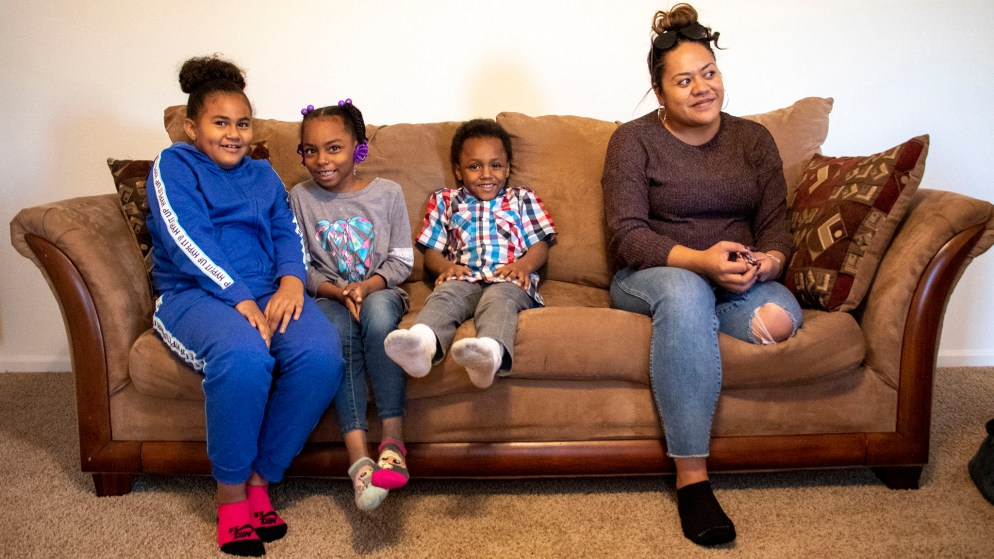 Mele Lavaka (right to left) sits on a couch in her new home with her boyfriend's kids, Dedric, KyLani and Na'Lonnie. Lochbuie, Colorado. Nov. 28, 2019. (Kevin J. Beaty/Denverite)