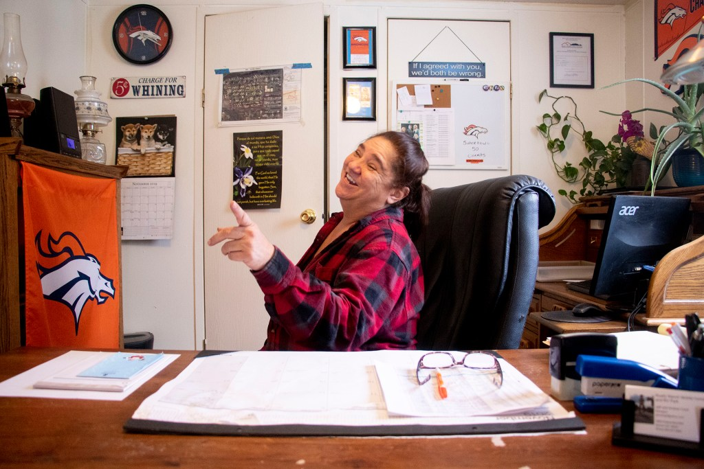 Andrea Cook, manager and lifelong resident of Rustic Ranch Mobile Home and RV Park off Federal Boulevard, speaks to a reporter in her office. Nov. 26. 2019. (Kevin J. Beaty/Denverite)