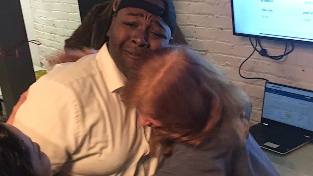Tay Anderson hugs a supporter as early returns show him leading in the race for an at-large Denver school board seat. (Chalkbeat)