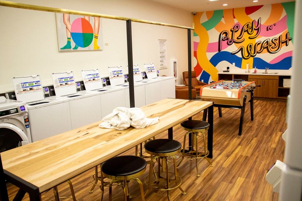 "Olive Moya's artwork inside the Quayle apartments' ""play n' wash."" Nov. 21, 2019. (Kevin J. Beaty/Denverite)"