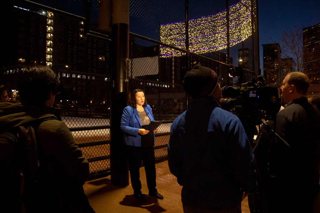 Britta Fisher, executive director of Denver's Department of Housing Stability, speaks to a small crowd after lights above Sonny Lawson Park in Five Points were illuminated to represent people counted in the 2019 annual Point In Time survey. Dec. 4, 2019. (Kevin J. Beaty/Denverite)