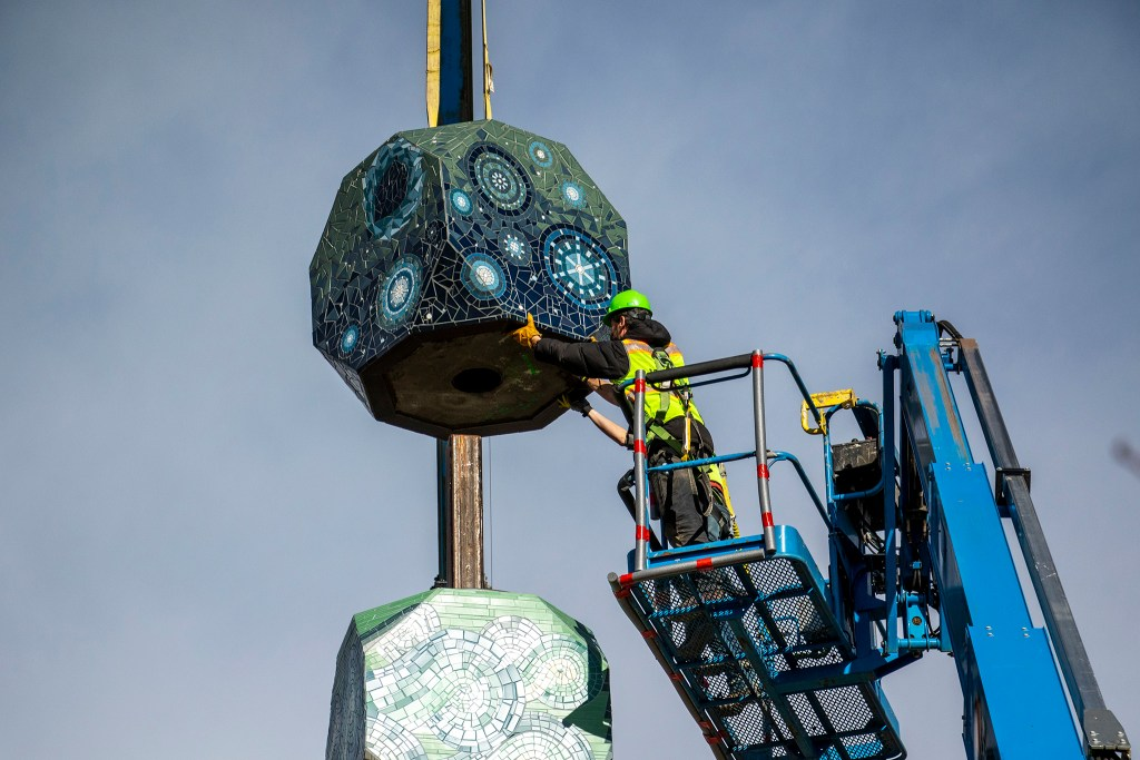"The final piece in Jaime Molina's ""La Veleta/The Weathervane"" is installed above Federal Boulevard from its new home at Barnum Park. Dec. 14, 2019. (Kevin J. Beaty/Denverite)"