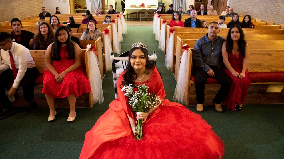 Kim Ramos sits in a chair adorned with lace before her quinceañera ceremony began. Ministerio Hispano Presbyterian Church, Dec 14, 2019. (Kevin J. Beaty/Denverite)
