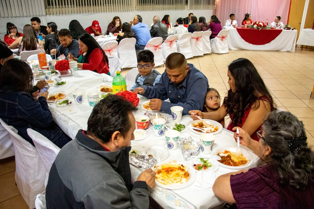 Kim Ramos' quinceañera party in the basement at Ministerio Hispano Presbyterian Church, Dec 14, 2019. (Kevin J. Beaty/Denverite)