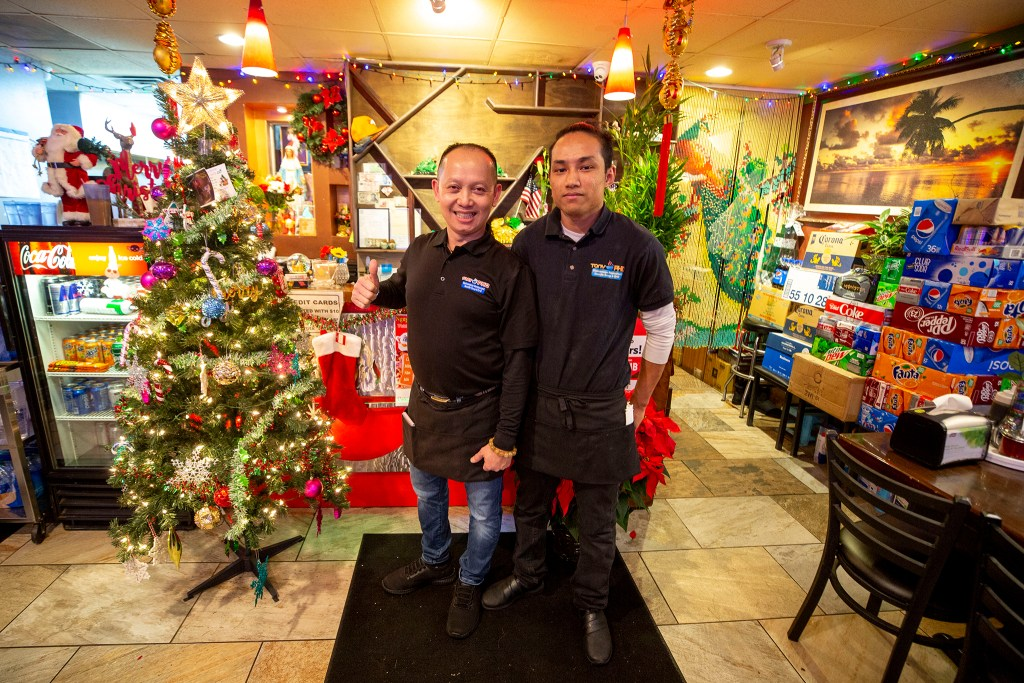 Tony Le and Duc Danh pose for a portrait inside Tony Pho on Christmas Eve. Federal Boulevard, Dec. 24, 2019. (Kevin J. Beaty/Denverite)