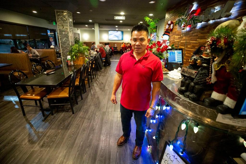 Mike Van poses for a portrait inside Saigon Bowl on Christmas Eve. Federal Boulevard, Dec. 24, 2019. (Kevin J. Beaty/Denverite)