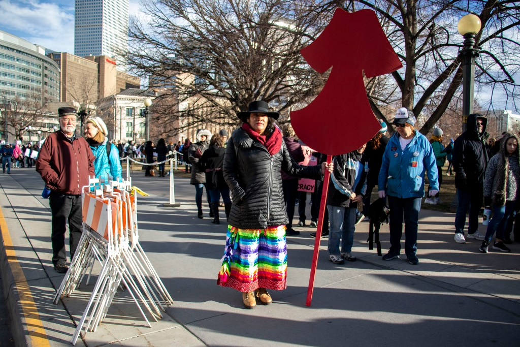 Molly Ryan Kills Enemy poses for a portrait before the Denver Womxn's March, Jan. 18, 2020. (Kevin J. Beaty/Denverite)