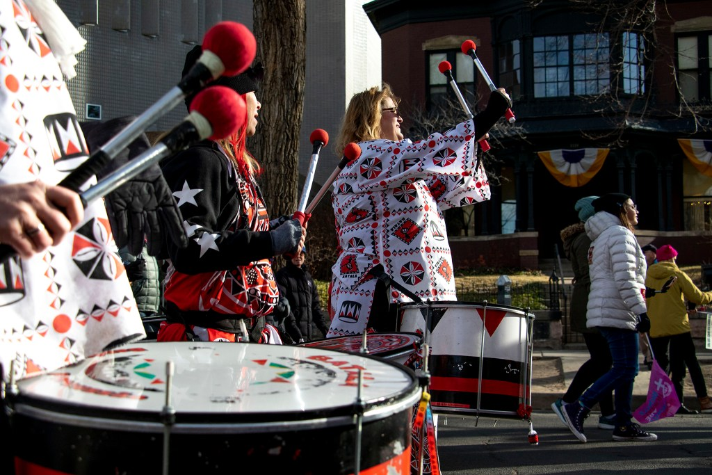 The Batala drum group lead the Denver Womxn's March, Jan. 18, 2020. (Kevin J. Beaty/Denverite)