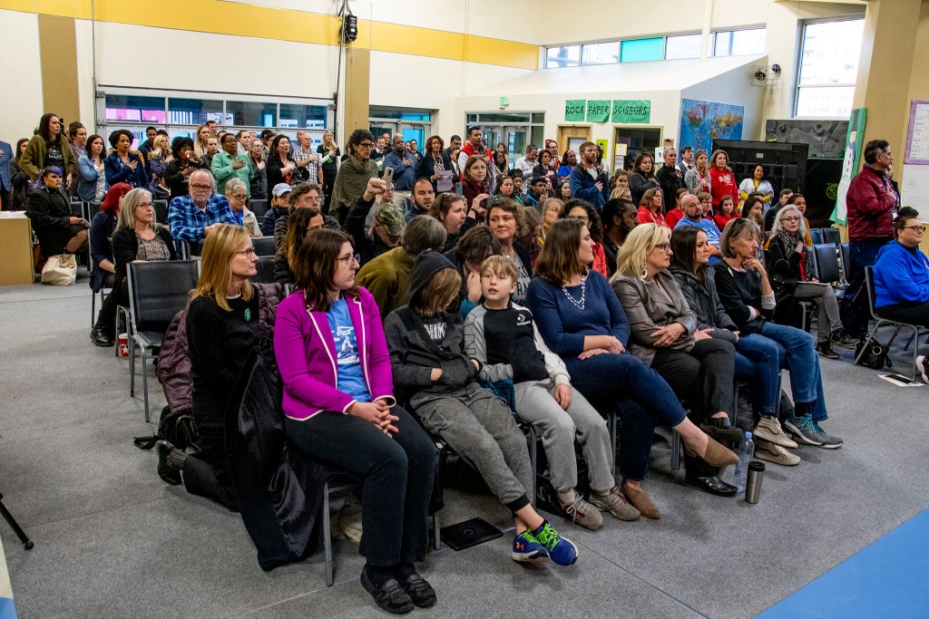 A large section of the audience did not stand during the Pledge of Allegiance at the Denver School Board's meeting on Jan. 23, 2020. (Kevin J. Beaty/Denverite)