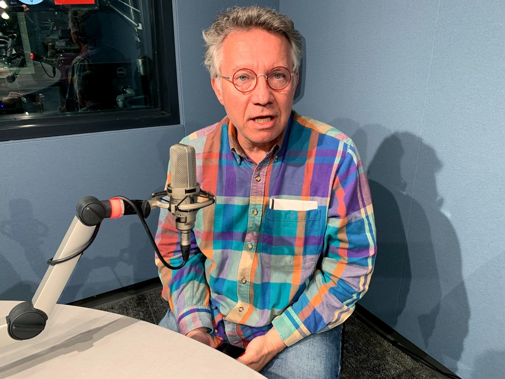 John A. Kite sits in a CPR recording studio. March 17, 2020. (Ryan Warner/CPR News)