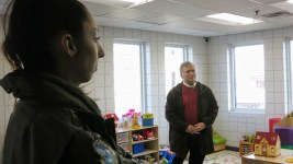 Councilwoman Candi CdeBaca in foreground and Councilman Kevin Flynn in backgroundat Samaritan House during a Jan. 9, 2020 tour of shelters. (Donna Bryson/Denverite)