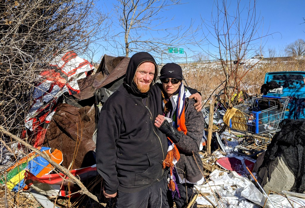 Floyd and Katrina Stolin pose for a portrait at their camp along the Sand Creek. Feb. 5, 2020. (Kevin J. Beaty/Denverite)
