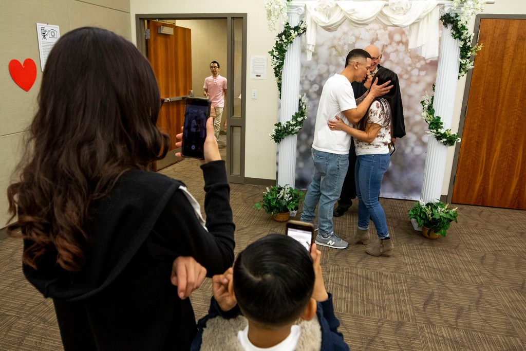 Thomas and Erika Zuniga get married on Valentine's Day at the office of Denver's Clerk and Recorder, Feb. 14, 2020. (Kevin J. Beaty/Denverite)