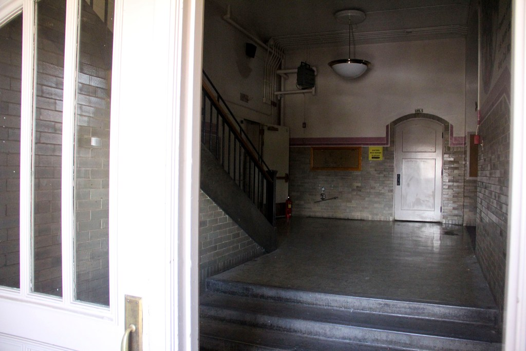 The entrance to the old Rosedale School in Denver's Rosedale neighborhood, Feb. 24, 2020. (Esteban L. Hernandez/Denverite)