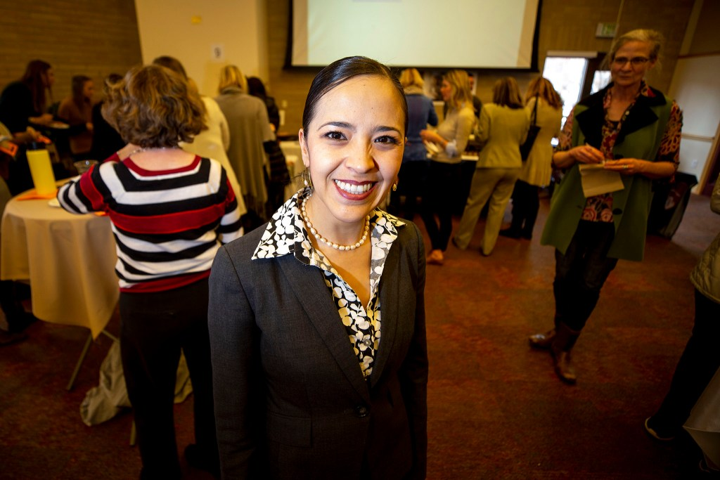 Yessica Holguin, director of Denver's Center for Community Wealth Building, poses for a portrait during a speed tasting event at the University of Denver. Feb. 25, 2020. (Kevin J. Beaty/Denverite)