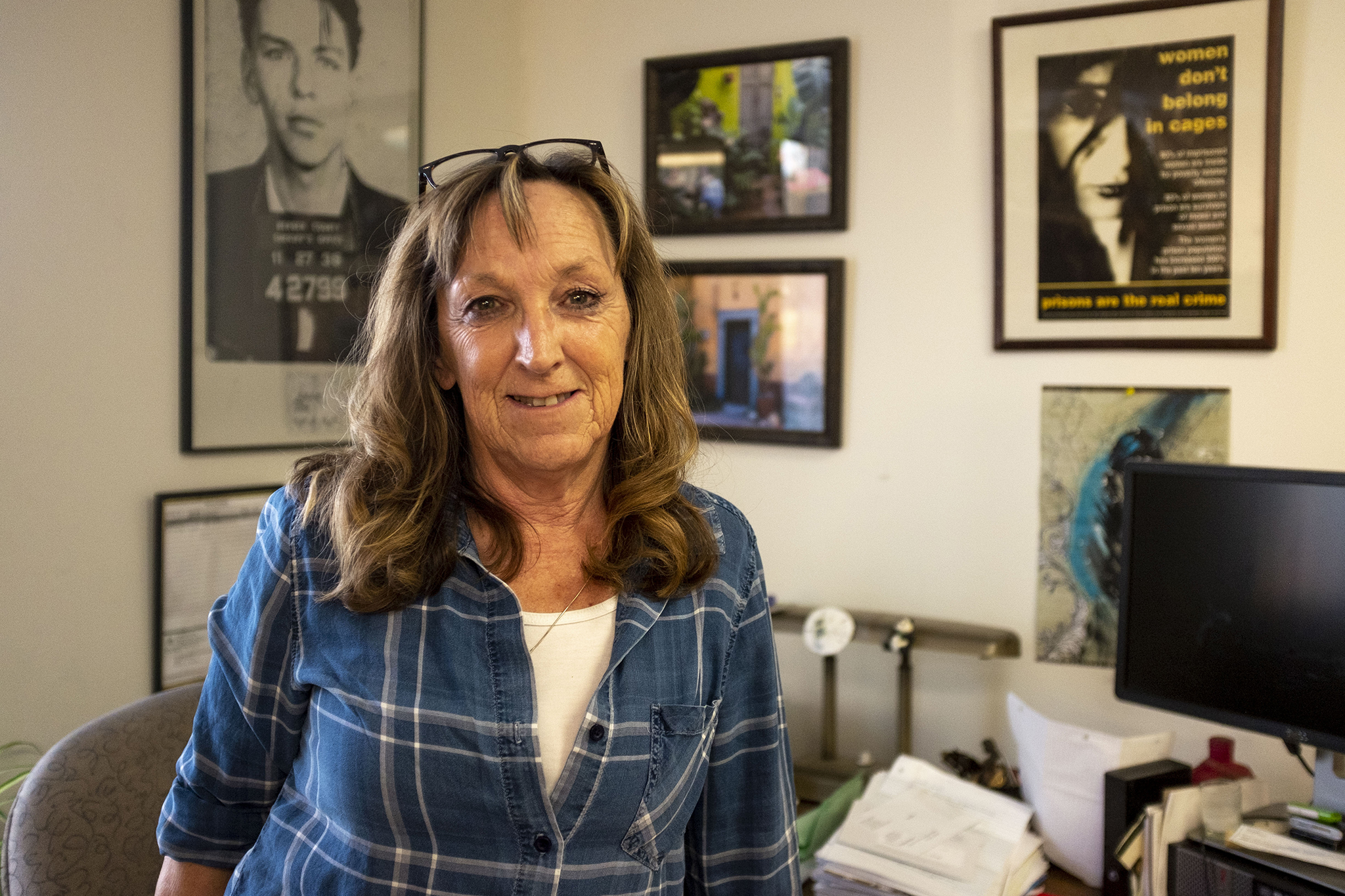Pam Clifton poses for a portrait in her office at the Inner City Parish where the Colorado Criminal Justice Reform Coalition is headquartered. Jan. 9, 2020. (Kevin J. Beaty/Denverite)
