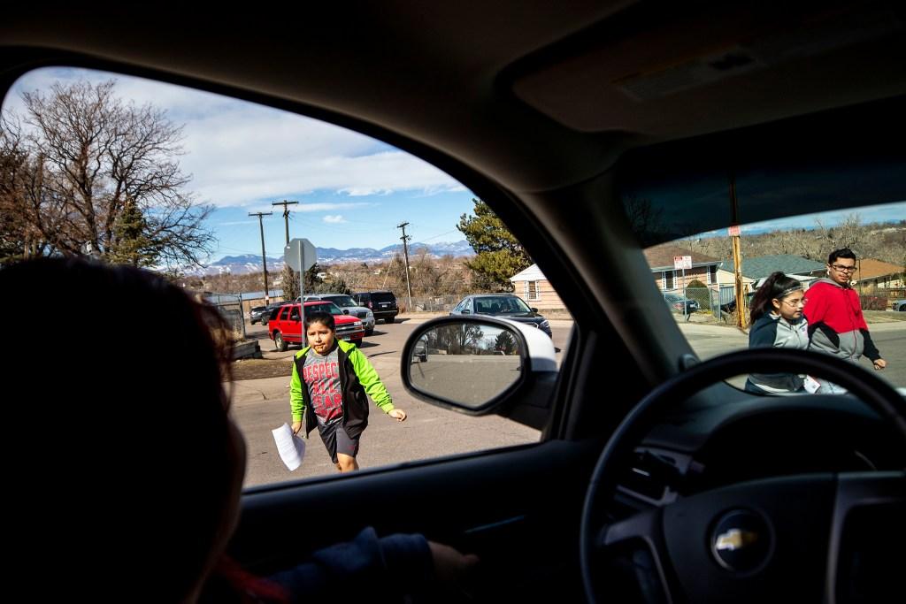 Christina Zaldivar picks her kids up from Sunday school. March 7, 2020. (Kevin J. Beaty/Denverite)