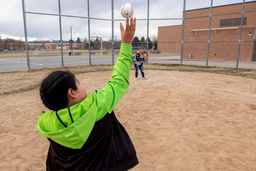 Christina Zaldivar plays baseball with her son, Francysco, in a park near their Bear Valley home. March 8, 2020. (Kevin J. Beaty/Denverite)