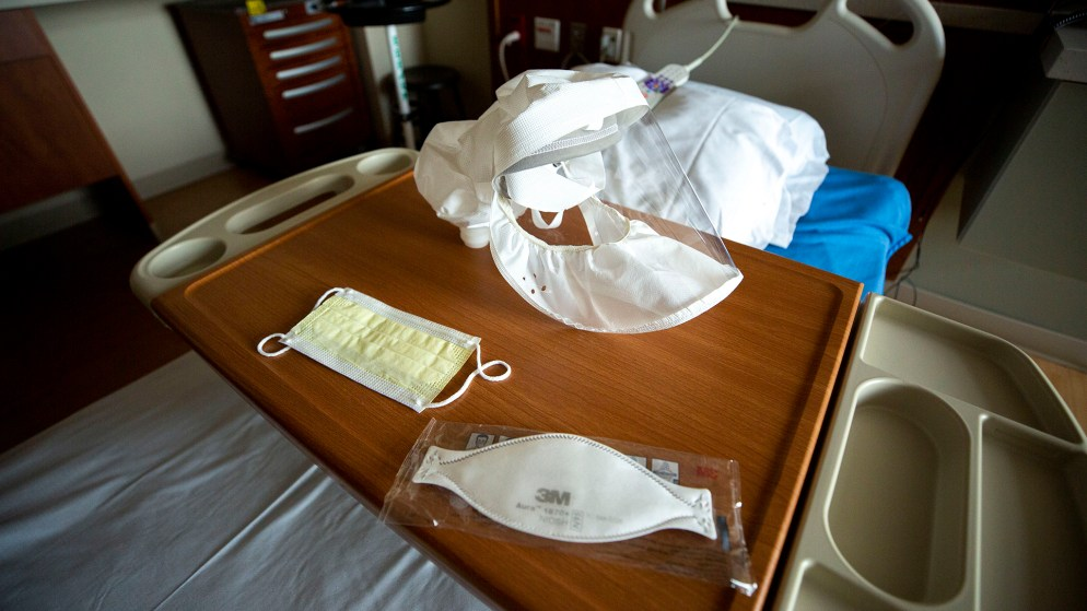 An array of medical masks on a bed at St. Joseph Hospital, March 10, 2020. (Kevin J. Beaty/Denverite)
