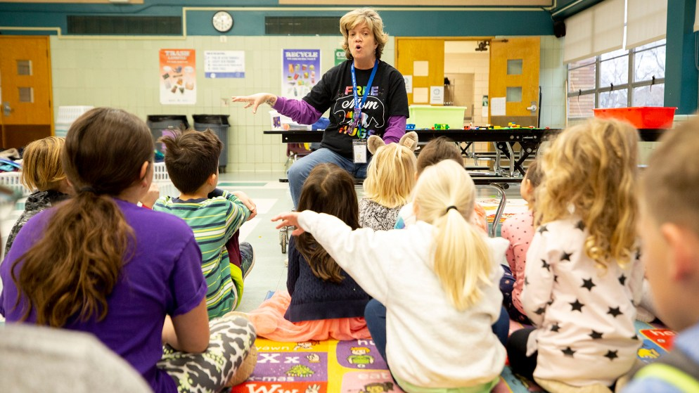 Discovery Link supervisor Jennifer Piel teaches kids at Carson Elementary how to wash their hands. March 13, 2020. (Kevin J. Beaty/Denverite)