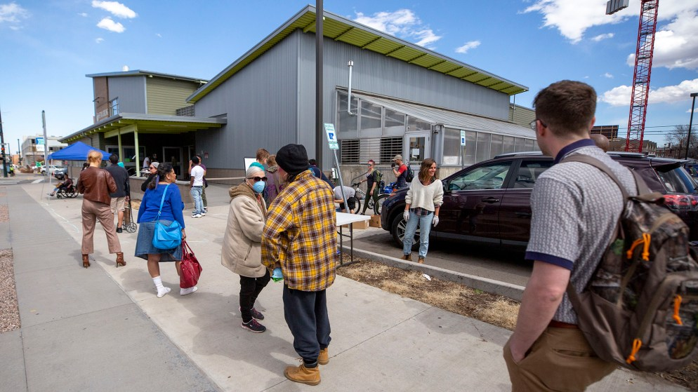 Metro Caring food pantry had to conduct business outside due to COVID-19 concerns, March 18, 2020. (Kevin J. Beaty/Denverite)