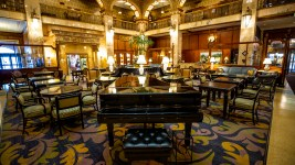 A vacant piano in the Brown Palace's empty tea lounge, March 19, 2020. (Kevin J. Beaty/Denverite)