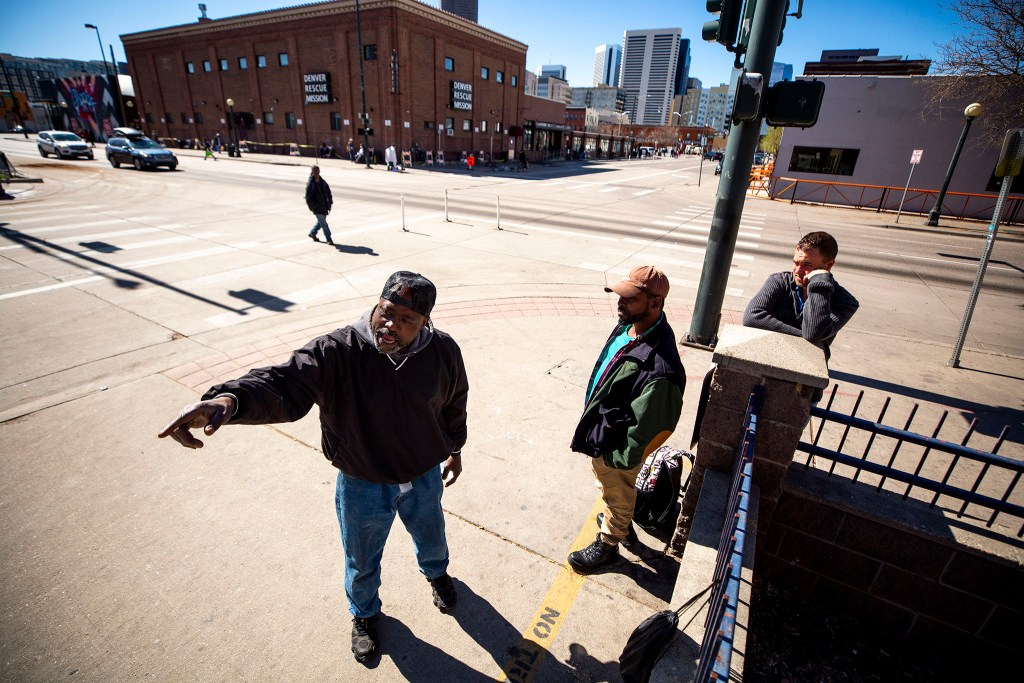 Robert McNeal, Davon Moss and Brandon Noord speak to a reporter in  front of the Denver Rescue Mission and Samaritan House. March 24, 2020. (Kevin J. Beaty/Denverite)