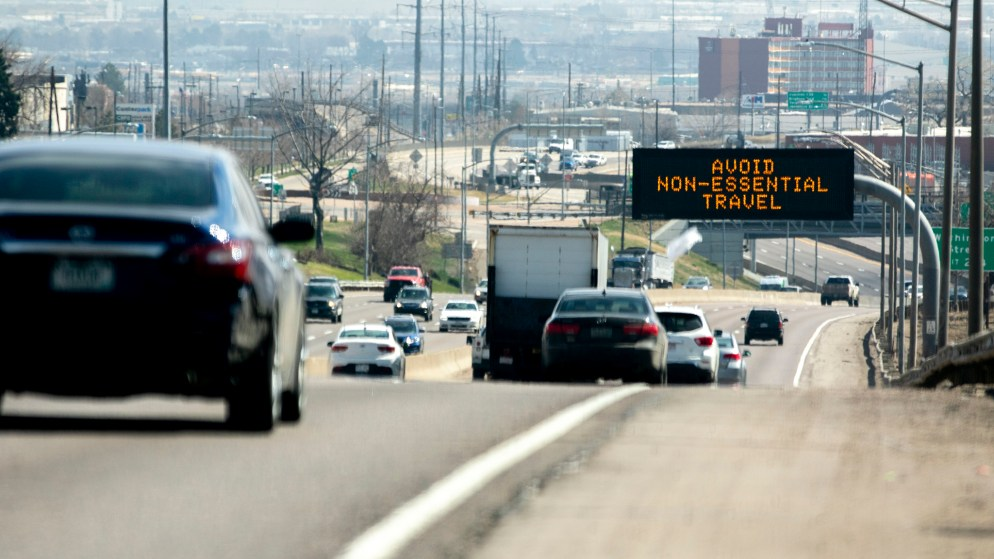 """Avoid non-essential travel."" I-70, March 26, 2020. (Kevin J. Beaty/Denverite)"