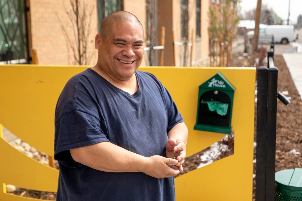 A man named Juan gets a box of food from the Mental Health Center of Denver. April 3, 2020. (Kevin J. Beaty/Denverite)