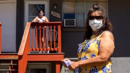 Tina Martinez (right) and Rose Peña, who live in Valverde, aren't sick and don't intend to catch COVID-19. They said they hardly leave home without masks. April 29, 2020. (Kevin J. Beaty/Denverite)